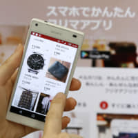 Clearing house: The Mercari flea market app is becoming increasingly popular with seniors in Japan wanting to sell their unneeded possessions. | KYODO.
