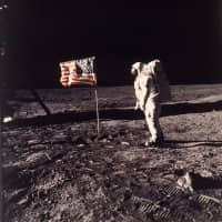 Astronaut Buzz Aldrin stands beside the U.S. flag on the moon on July 20, 1969. | AP
