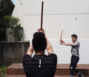 Shindo, a personal fitness regime based on kendo moves and philosophy, was devised by Kiyotaka Hanazawa, seen here teaching students at his studio in Tokyo. | DYLAN FOLEY