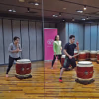 Keeping to the beat: Taikobics instructor Kenjiro Ishida shows students how to taiko drum and exercise at the same time. | DYLAN FOLEY
