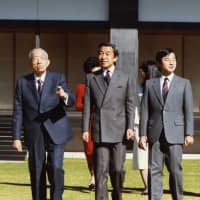 Emperor Hirohito, Crown Prince Akihito and his grandson Prince Hiro (later Crown Prince Naruhito) stroll through the Imperial Palace on Nov. 22, 1987. They went on to become three generations of emperors through the eras of Showa, Heisei and now Reiwa. | KYODO