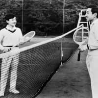 Prince Hiro plays tennis with his father Crown Prince Akihito in Tokyo on March 5, 1973. | AFP-JIJI
