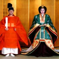 Crown Prince Naruhito and his bride, Masako Owada, dress in full traditional imperial wedding costumes at the Imperial Palace on Jun. 2, 1993. | AFP-JIJI