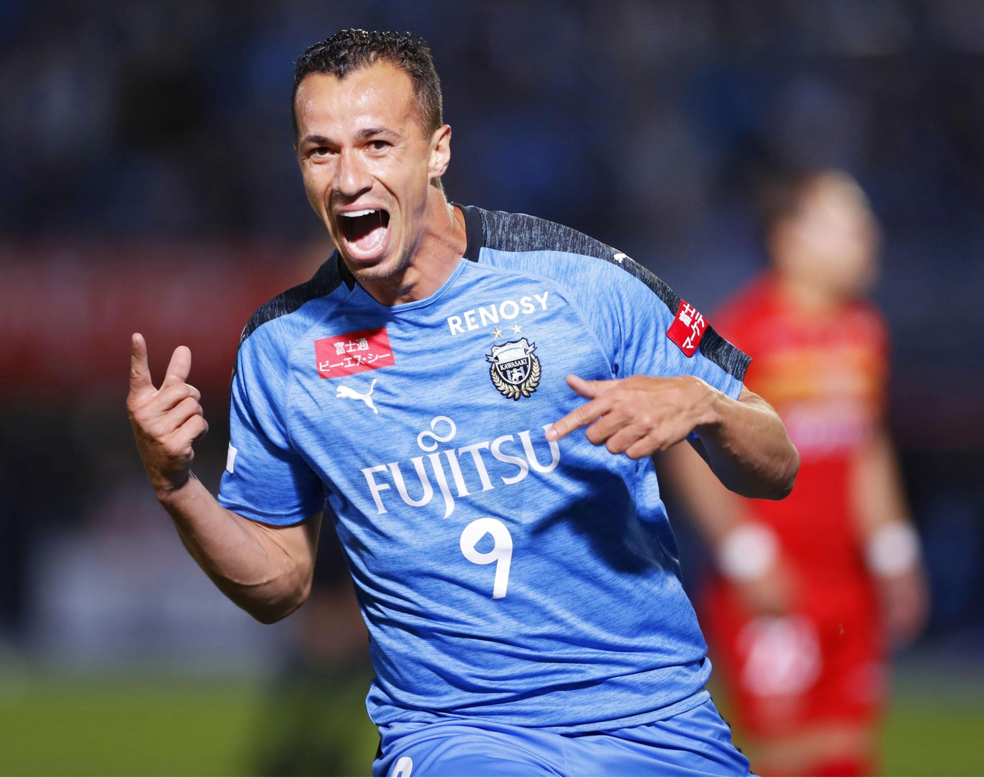 Kawasaki Frontale's Leandro Damiao celebrates his second-half goal against Nagoya Grampus on Friday night at Todoroki Stadium. The match ended in a 1-1 draw.   KYODO