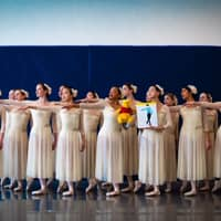 Members of the Crescendo Conservatory in Overland Park, Kansas, pose with a portrait of Yuzuru Hanyu and Winnie the Pooh during a recent rehearsal. | GAVIN DEYOUNG DANIELS