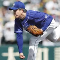 Dragons starter Yuya Yanagi pitches against the Tigers on Saturday. | KYODO