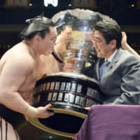 Sumo attracts famous politicians seeking public affection, attention