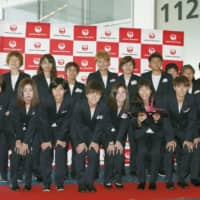 Nadeshiko Japan poses at Haneda airport on Monday ahead of the team's departure for the 2019 FIFA Women's World Cup in France. | KYODO