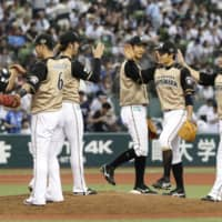 Fighters players celebrate their comeback win over the Lions on Sunday at MetLife Dome. | KYODO