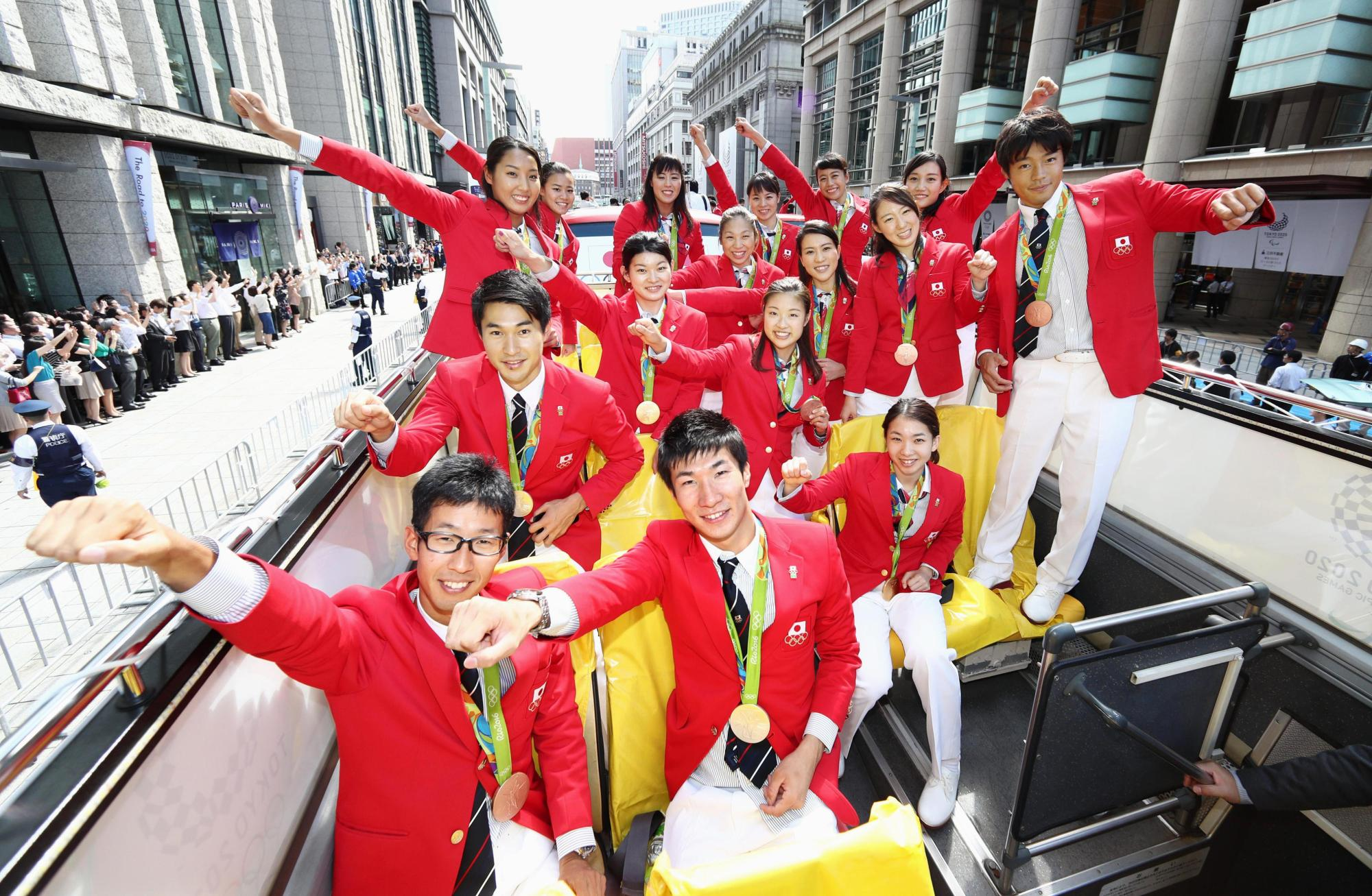 Rio Olympians pose during a parade to honor medal winners from the 2016 Rio Olympics and Paralympics on Oct. 7, 2016, in Tokyo's Ginza district. Japanese athletes earned 12 gold medals and 41 overall during the Rio Games, as well as 24 medals overall in the Paralympics. | KYODO