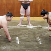 Takayasu (right) faces off against Shodai during a training session on Jan. 6 in Tokyo. | KYODO