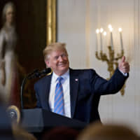 U.S. President Donald Trump gives a thumbs up during a Celebration of Military Mothers event on Friday in Washington. Trump is expected to present a trophy to the winner of the Summer Basho on May 26 at Ryogoku Kokugikan.   BLOOMBERG