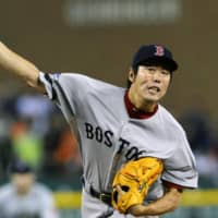 Red Sox pitcher Koji Uehara pitches during the 2013 American League Championship Series in Detroit.   KYODO
