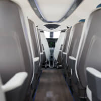 Passenger seats stand behind the open-plan cockpit of an Alice'electric aircraft manufactured by Eviation Aircraft Ltd., during the 53rd International Paris Air Show at Le Bourget, in Paris on Tuesday. | BLOOMBERG