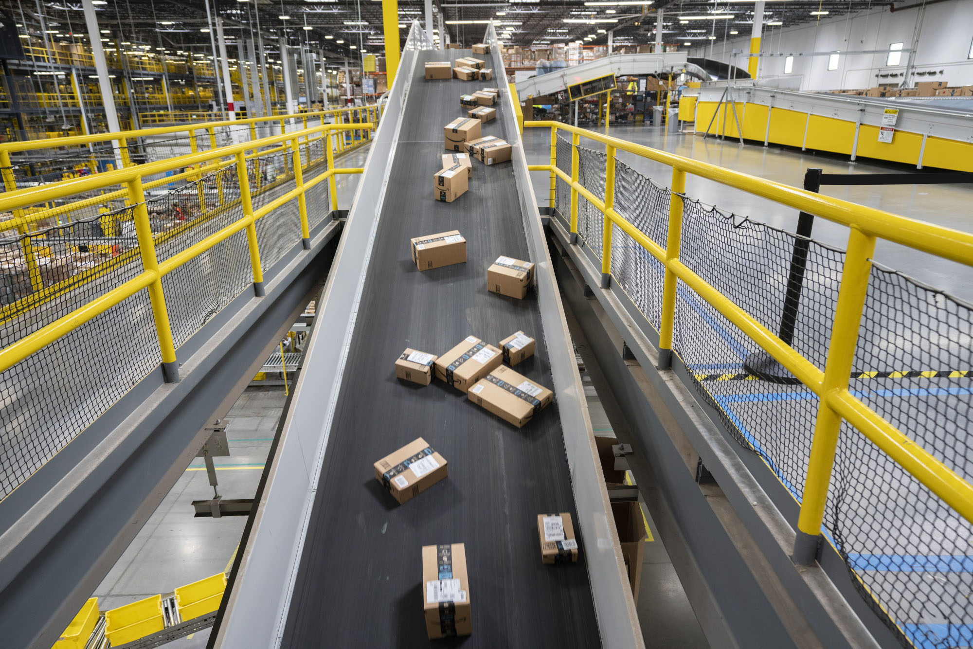 Packages are sorted at an Amazon.com Inc. fulfillment center in Baltimore. | BLOOMBERG