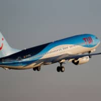 A TUI fly Boeing 737-800 takes off from the airport in Palma de Mallorca, Spain, last July. | REUTERS