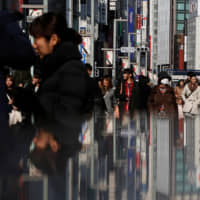 January-March GDP has been upgraded but analysts say weak consumption still remains a concern. | REUTERS