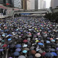 Protesters gather near the Legislative Council in Hong Kong on Wednesday as the administration prepared to open debate on a highly controversial extradition law that would allow accused people to be sent to China for trial.   AP