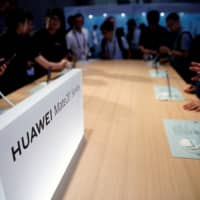 The Huawei company logo is seen at CES (Consumer Electronics Show) Asia 2019 in Shanghai Tuesday. | REUTERS