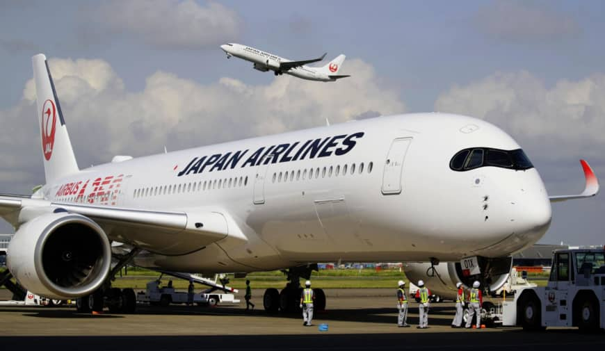 An Airbus A350 plane arrives at Haneda airport in Tokyo on Friday from France. The plane is the first of 31 that will be used by Japan Airlines Co. on its domestic and international routes.   KYODO