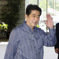Prime Minister Shinzo Abe arrives at his office in Tokyo on Tuesday. | KYODO