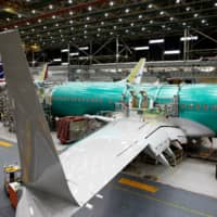 A 737 Max aircraft is pictured at the Boeing factory in Renton, Washington, March 27. | REUTERS