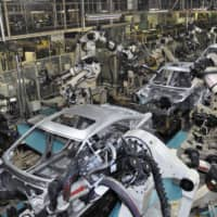 Cars are built on an assembly line at Mazda Motor Corp.'s plant in Yamaguchi Prefecture. Japan's industrial output rose 2.3 percent in May from the previous month, helped by robust auto production.   KYODO