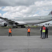 An Airbus SE A350 passenger aircraft, operated by Qatar Airways Ltd., taxis ahead of the 53rd International Paris Air Show at Le Bourget in Paris on Sunday. | BLOOMBERG