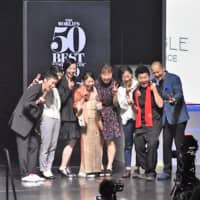 Chef Zaiyu Hasegawa (second from right) and his team from Japanese restaurant Den receive the Art of Hospitality award at the World's 50 Best Restaurants awards ceremony on Wednesday at Marina Bay Sands in Singapore. | KYODO