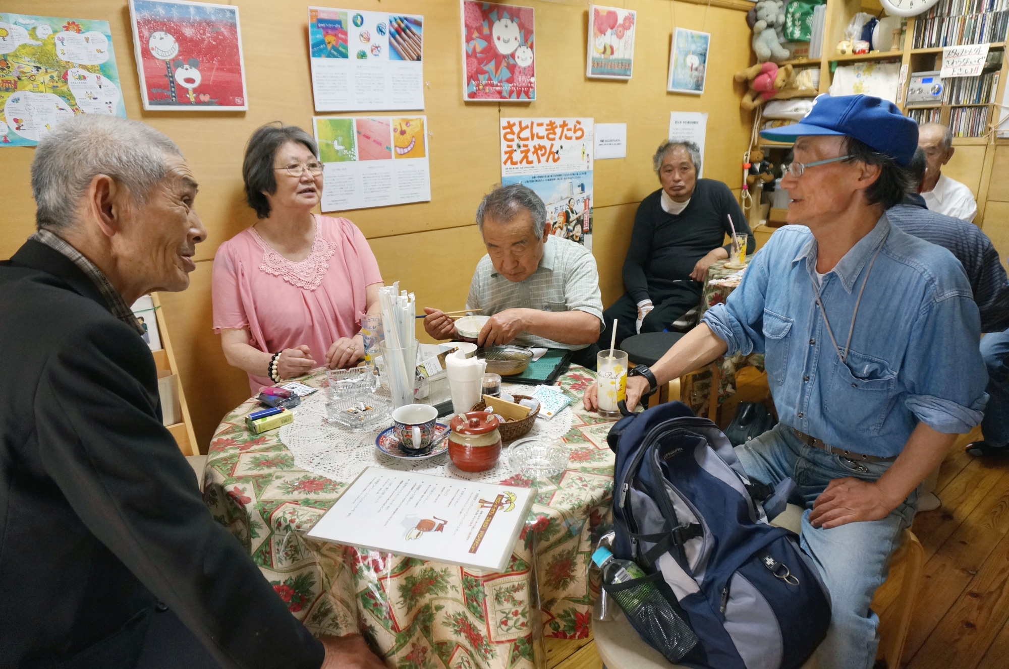Elderly people eat, drink and chat at a cafe in central Tokyo. | KYODO