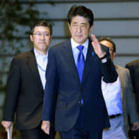 Japanese businesses see economy peaking out, want more stimulus: poll