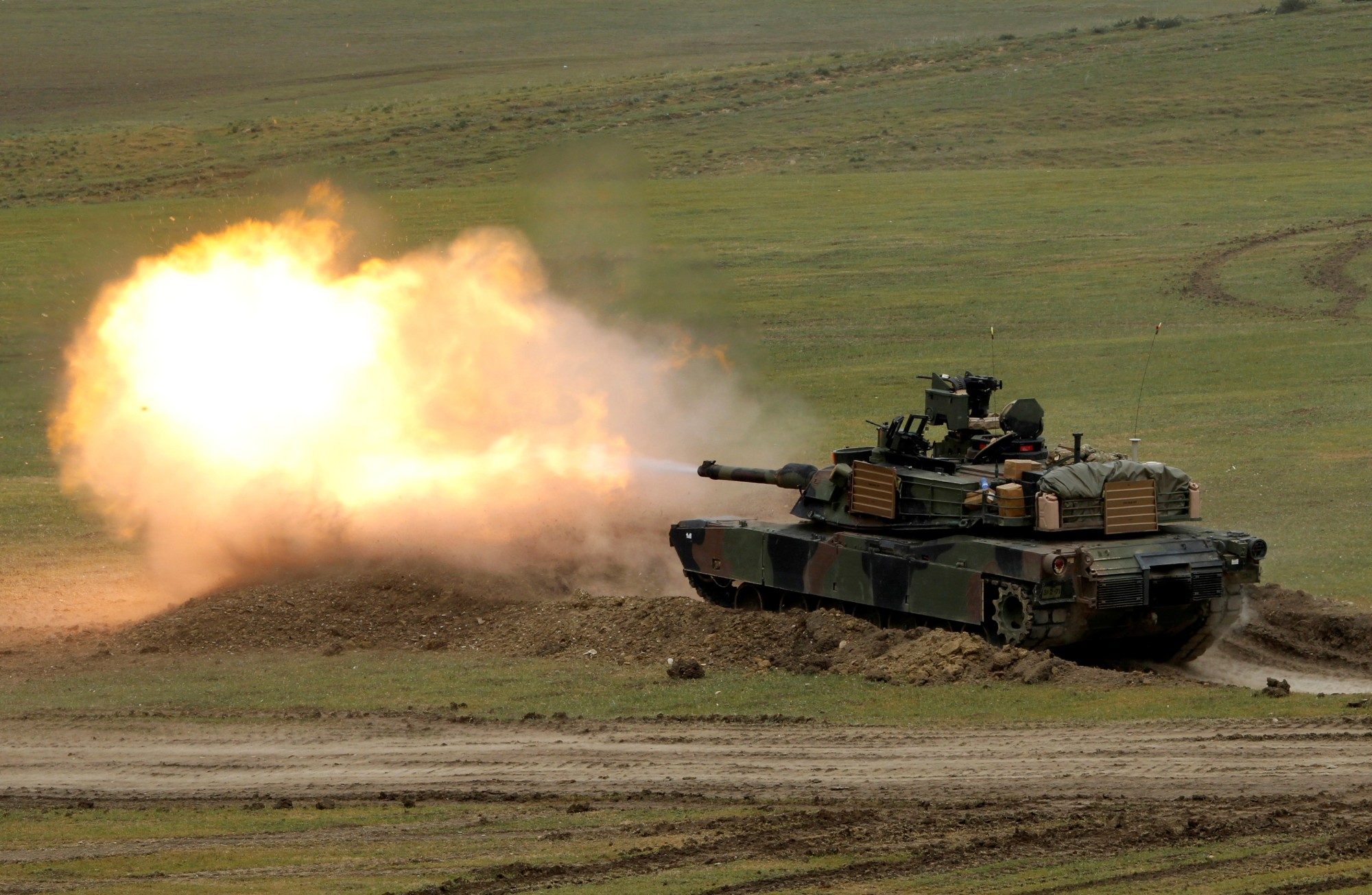 A U.S. M1A2 Abrams tank fires during the U.S. led joint military exercise 'Noble Partner 2016' near Vaziani, Georgia, in 2016. | REUTERS