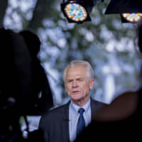 Peter Navarro, director of the National Trade Council, speaks during a television interview outside the White House in Washington May 31. | BLOOMBERG
