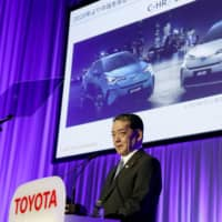 Toyota Motor Corp. Executive Vice President Shigeki Terashi briefs reporters on its electric vehicle business on Friday in Tokyo. | KYODO