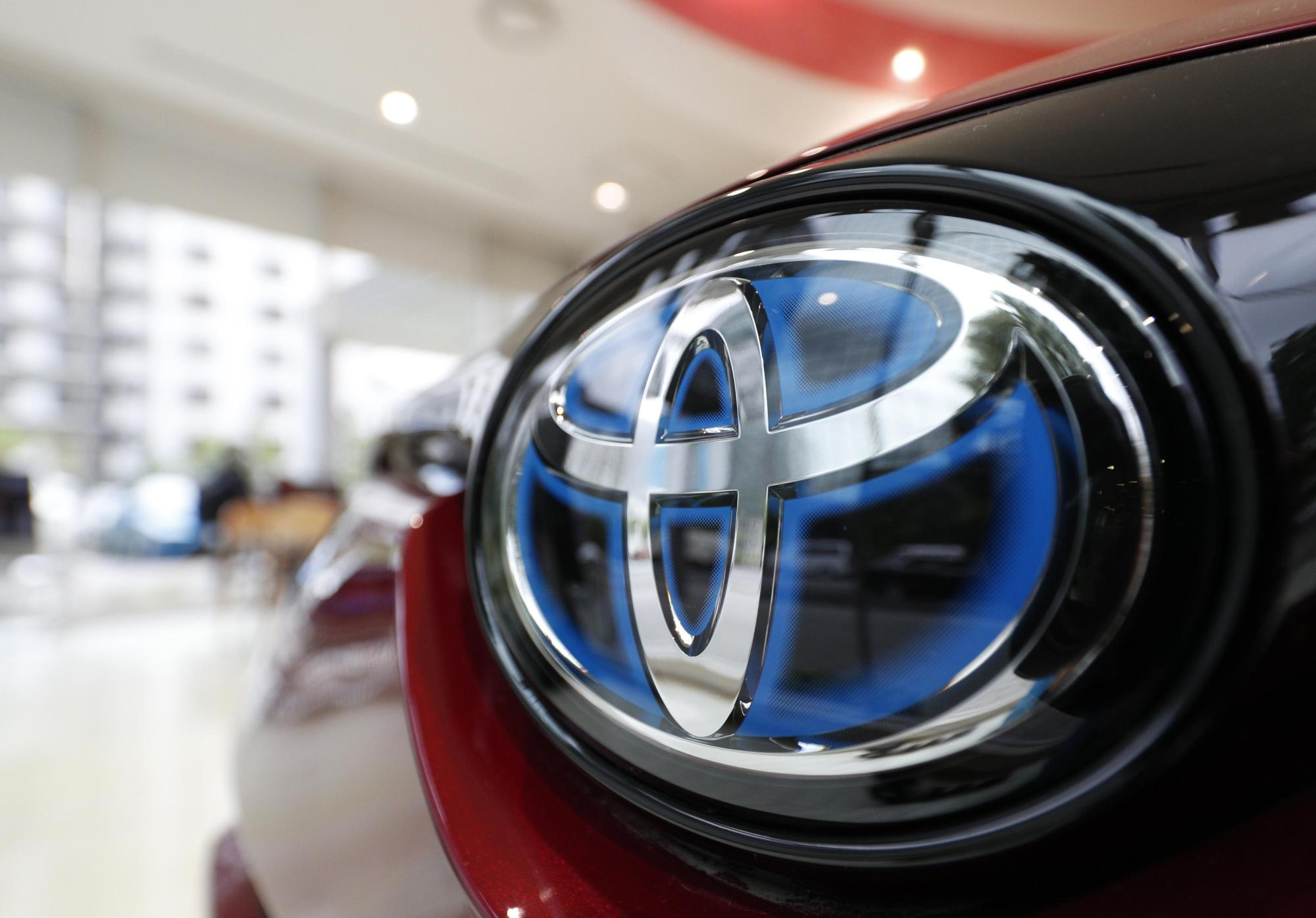 Toyota cars are displayed at a Toyopet dealership in Tokyo's Minato Ward. | KYODO