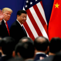 U.S. President Donald Trump and Chinese leader Xi Jinping meet business leaders at the Great Hall of the People in Beijing in November 2017. | REUTERS
