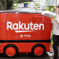 E-commerce firm Rakuten Inc. shows an unmanned ground vehicle developed by China's e-commerce company JD.com Inc. at the economy ministry in Tokyo on Monday.   KYODO