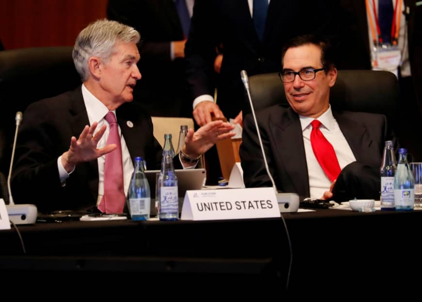 U.S. Federal Reserve Chairman Jerome Powell talks with U.S. Treasury Secretary Steven Mnuchin during the G20 finance ministers and central bank governors meeting in Fukuoka on Saturday. | REUTERS