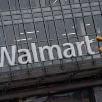 The Walmart logo is seen on a store in Washington in march. International retail giant Walmart agreed to pay $282 million to settle charges over potentially illegal payments to foreign officials in Brazil, China, India and Mexico, the U..S Securities and Exchange Commission announced on Thursday. | AFP-JIJI