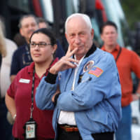 Former Apollo astronaut Al Worden (right) arrives at the VIP viewing site for launch of the Ares I-X test rocket at the Kennedy Space Center in Cape Canaveral, Florida, in 2009. The test rocket is being evaluated as a vehicle to replace the space shuttle for U.S manned spaceflight. | REUTERS
