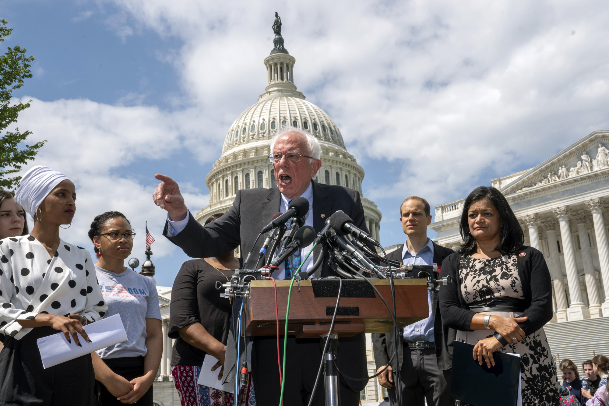 Democratic presidential candidate Sen. Bernie Sanders, I-Vt., flanked by Rep. Ilhan Omar, D-Minn. (left) and Rep. Pramila Jayapal, D-Wash., calls for legislation to cancel all student debt, at the Capitol in Washington Monday. Sanders called the student debt burden in this country the absurdity of sentencing an entire generation, the millennial generation, to a lifetime of debt for the crime of doing the right thing. | AP