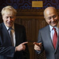 Britain's Conservative Party leadership contender Boris Johnson (left) meets with President of Iraq Barham Salih at the Houses of Parliament in London Wednesday. The two contenders, Jeremy Hunt and Johnson, face election by party members of Britain's Conservative Party with the winner due to replace Prime Minister Theresa May as party leader and prime minister. | DOMINIC LIPINSKI / PA / VIA AP