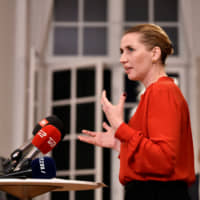 Mette Frederiksen addresses the press after finalizing government negotiations at Christiansborg Castle in Copenhagen shortly after midnight on Wednesday. | RITZAU SCANPIX / VIA REUTERS