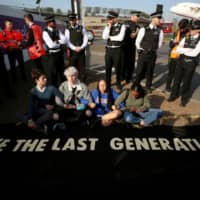 Climate change activists attend an Extinction Rebellion protest outside Heathrow Airport in London on April 19. | REUTERS