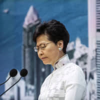 Hong Kong Chief Executive Carrie Lam gives a news conference on Saturday at which she announced the government will indefinitely suspend consideration of a China-backed extradition bill that has triggered some of the biggest mass protests since the former British colony's return to China. She has refused to step down, but her ability to govern has been questioned on numerous fronts. | BLOOMBERG