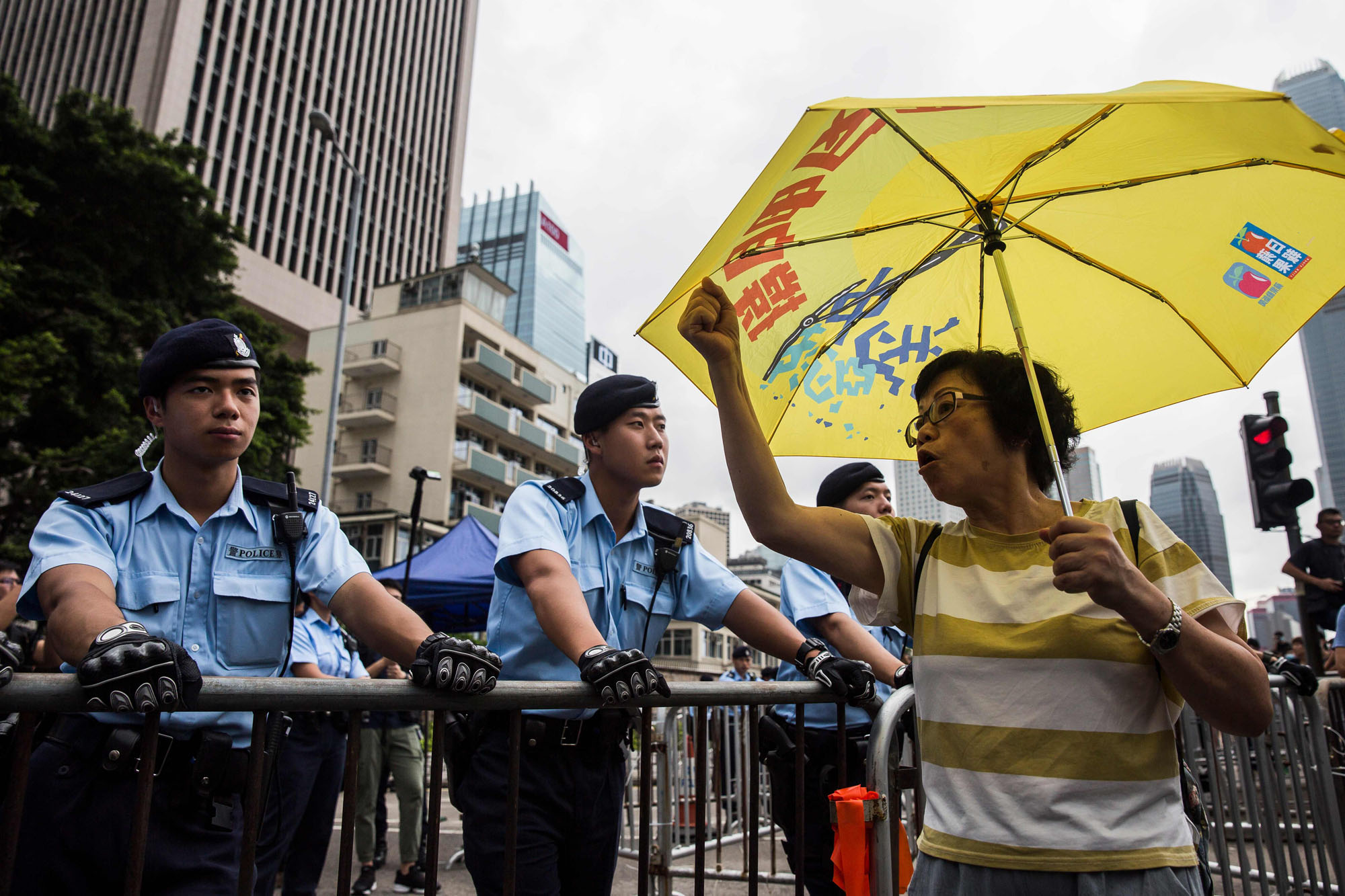 A protester shouts in front of police as a group of demonstrators rally outside the Legislative Council in Hong Kong on Monday. | AFP-JIJI