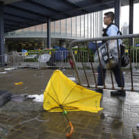 Hong Kong shuts government offices; security tight after violent protests