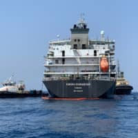 A picture taken during a guided tour by the U.S. Navy (NAVCENT) shows the Japanese oil tanker Kokuka Courageous off the port of the Gulf emirate of Fujairah on Wednesday. The tanker attacked in the Gulf of Oman last week was damaged by a limpet mine resembling Iranian mines, the U.S. military in the Middle East said. | AFP-JIJI