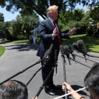 U.S. President Donald Trump speaks to the news media as he departs for travel to Iowa from the South Lawn of the White House in Washington Tuesday.   REUTERS