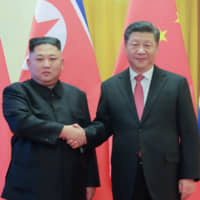 North Korean leader Kim Jong Un shakes hands with Chinese President Xi Jinping during a welcome ceremony at the Great Hall of the People in Beijing in January. | KCNA / KNS / VIA AFP-JIJI